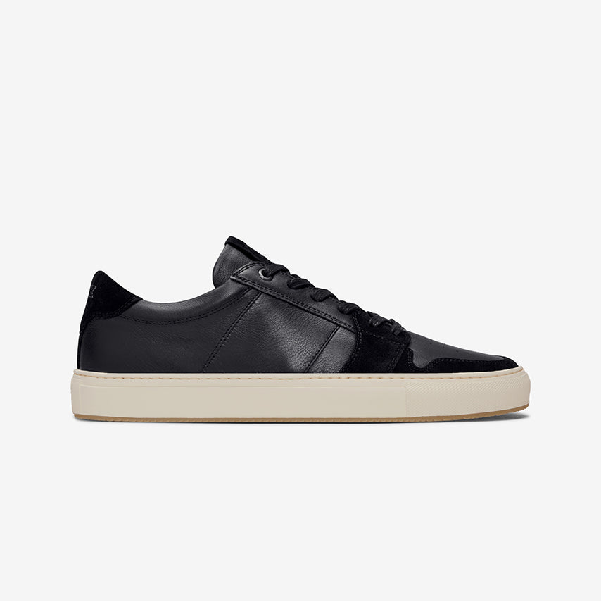 Profile view of the Men's Court Sneaker in Nero Black upper /  cream sole