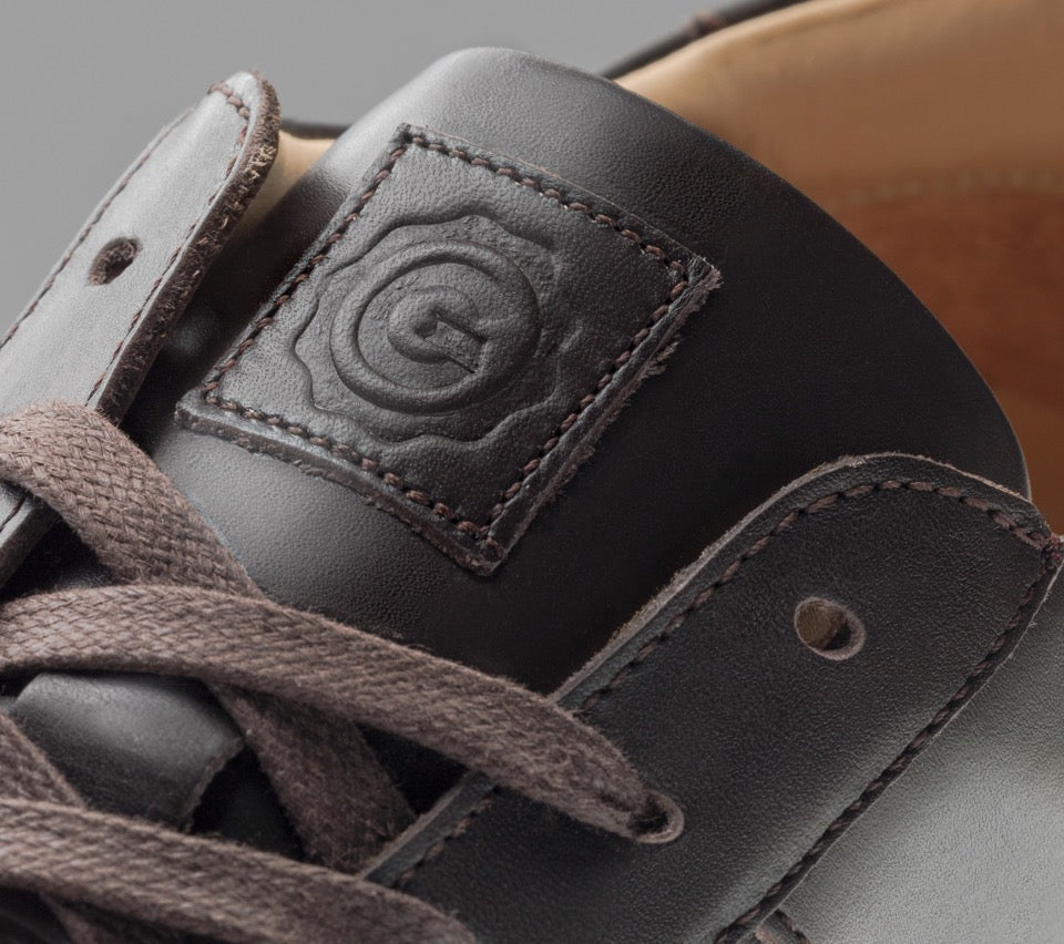 Detailed view of the tongue and laces of the Men's Royale Sneaker in Chocolate Brown / vintage sole.