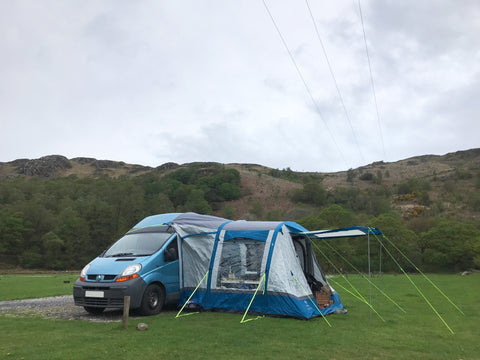 a campervan and a driveaway awning on a campsite in the Lake District