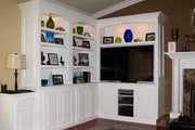 L-Shaped White Entertainment Center With Glass Door For Audio Equipment