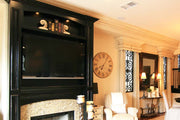 Antiqued Black Fireplace Mantel with Arched Cabinet Above