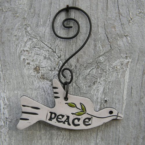Photograph of a white stoneware peace dove