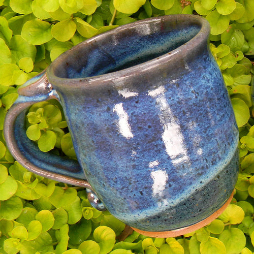 Photograph of blue glazed pottery mug