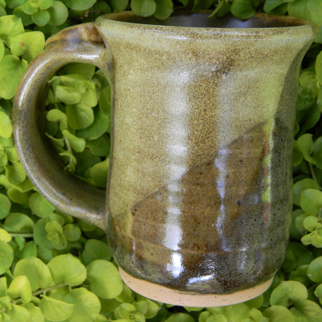 Photograph of a stoneware pottery mug in earthy browns