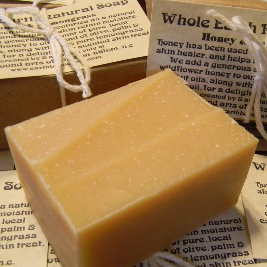 Photograph of a bar of Earthbound Arts honey lemongrass soap