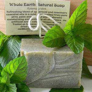 Photograph of a bar of Earthbound Arts rosemary mint soap