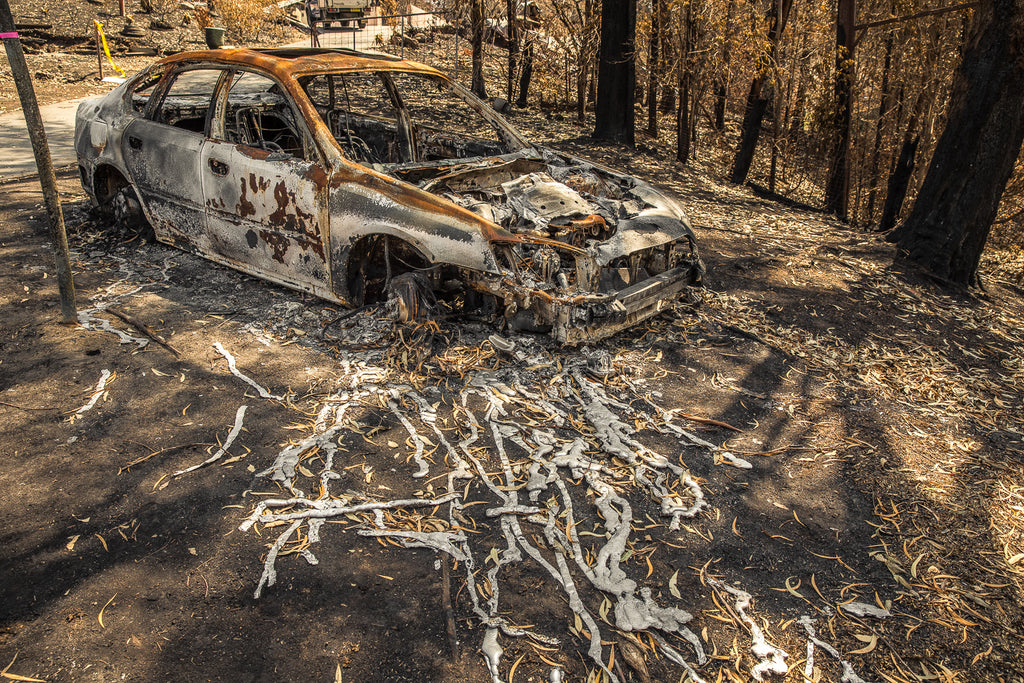 Australian bush fires on the south east coast of NSW burnt out melted car