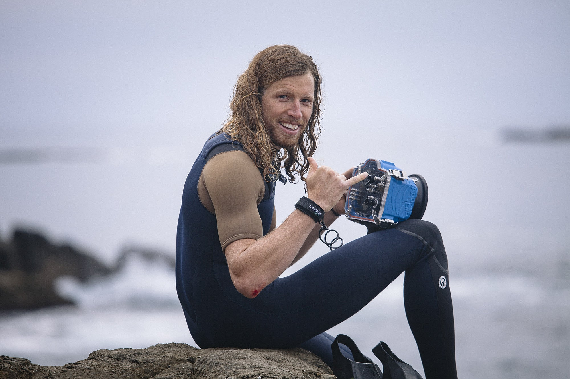 Portrait of Philip Thurston using his Canon Camera and AquaTech surf housing