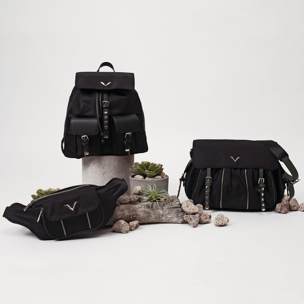 the lovve active collection is shown on a grey background along with rocks and plants