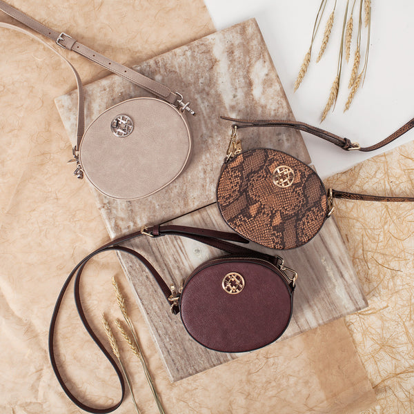 lovve olivia oval bags are shown overhead on top of a piece of tile and beige papers