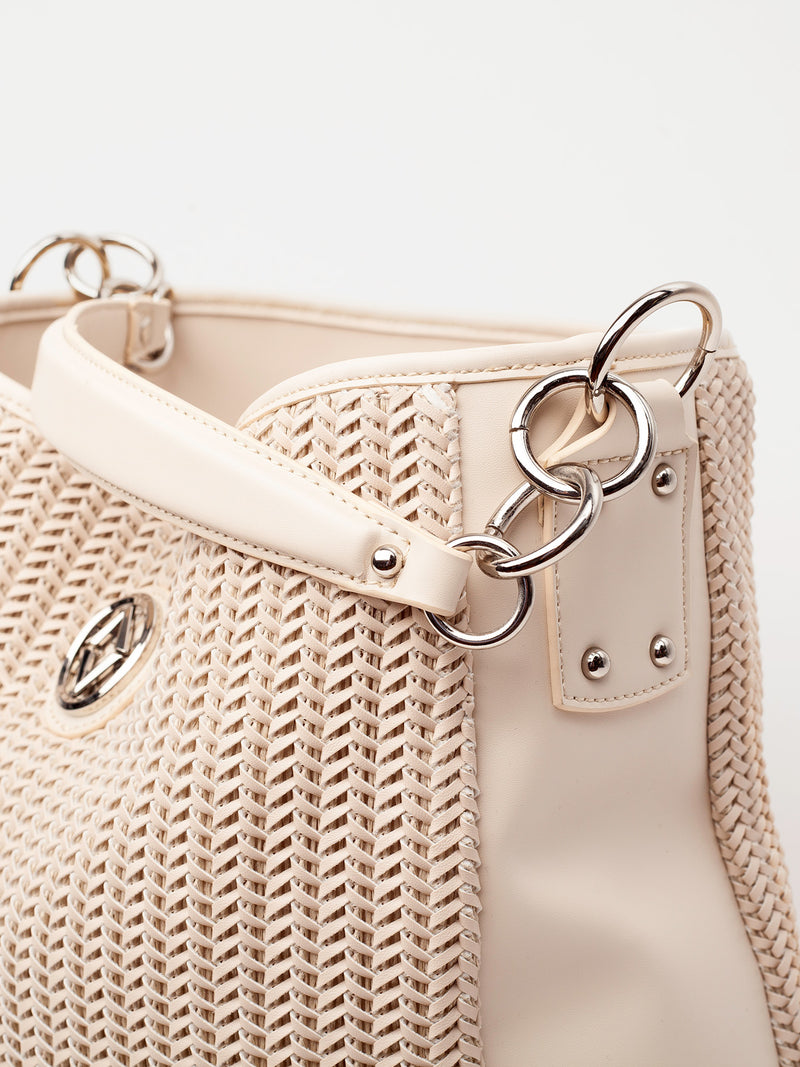 "Lovve bag ""wendy woven"" in nude is shown from a front angle with a focus on the side of the bag"