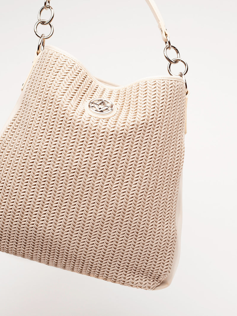 "Lovve bag ""wendy woven"" in nude is shown from the front and tilted at an angle"