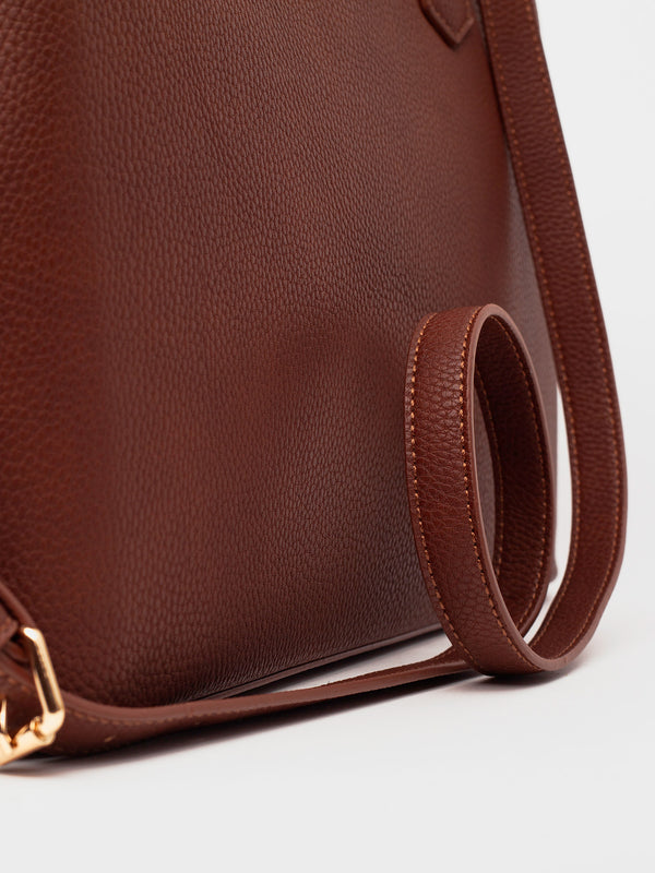 Lovve whiskey colored cassy satchel bag close up image of strap