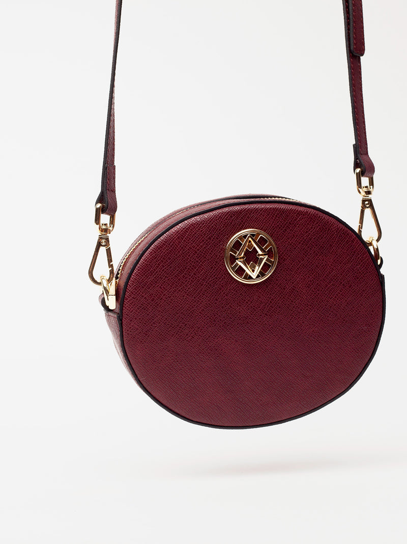 Lovve burgundy olivia oval bag hangs in frame