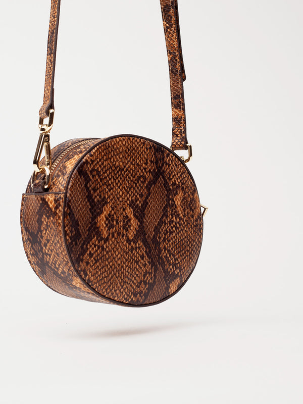 Lovve snakeskin olivia oval bag hangs into frame and is shot from the back