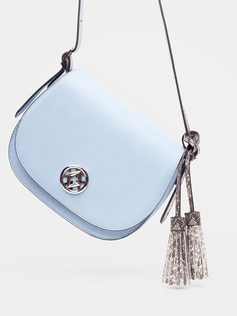 tonya tassel in blue hangs at an angle in the frame