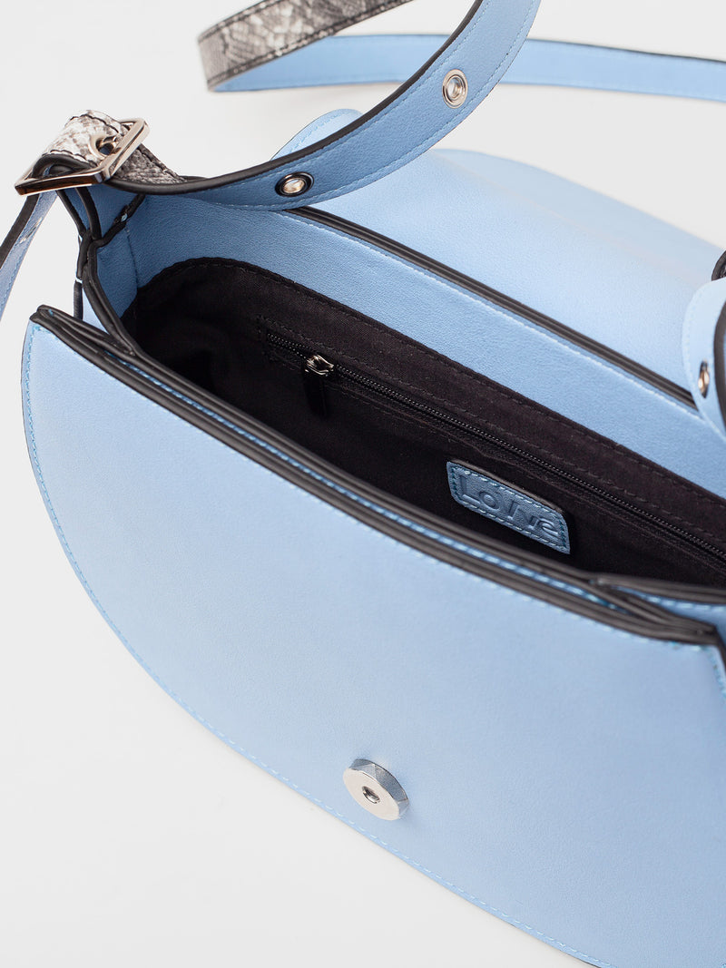 tonya tassel in blue showcases the inside of the bag