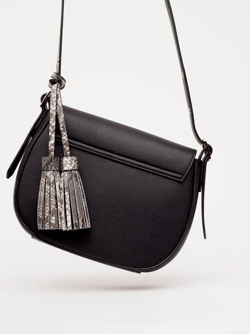 tonya tassel in black is shown from the back