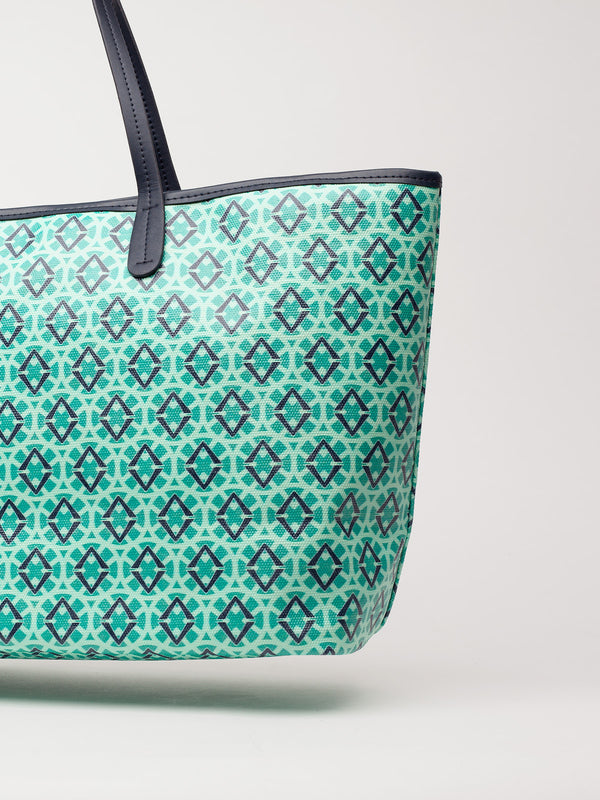 Lovve signature print tote is shown in green/navy in a close up view