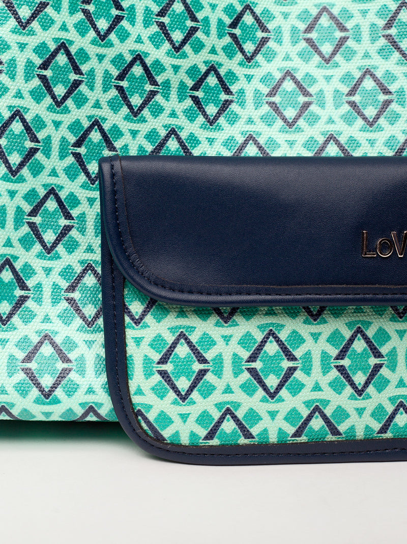 Lovve signature print tote is shown in green/navy and displays the inner wallet that is attached