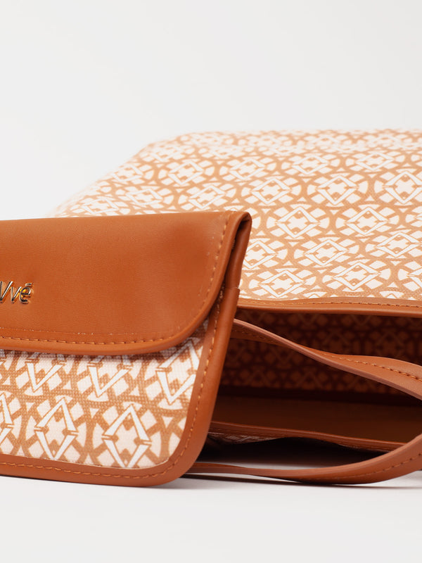 Lovve signature print tote is shown in tan/wheat w/ the inner wallet close to the camera
