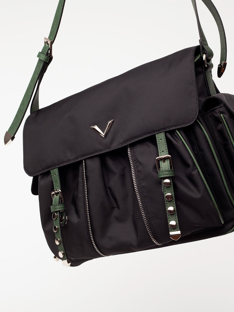 Lovve shayla shoulder bag shot hangs into frame and is shot from a front angle