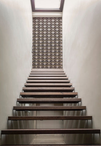 walls are demure in off whites and every corner is sharp the passages and stairway feel like passing through a calm contemporary museum the ones you want