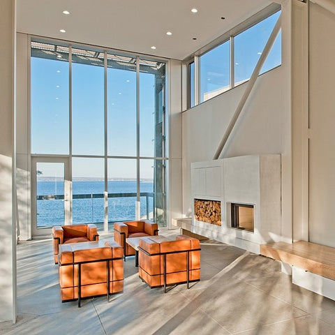 safe inside through the glass front the dramatic landscape and thrashing waters are the main feature with comfort and calm within the house harnesses
