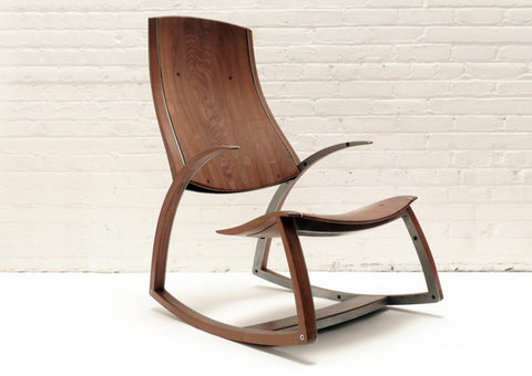 The Answer Is That The Elegant Shaping Of The Walnut Conceals A Steel  Skeleton Making This Cantilevered Chair Possible.