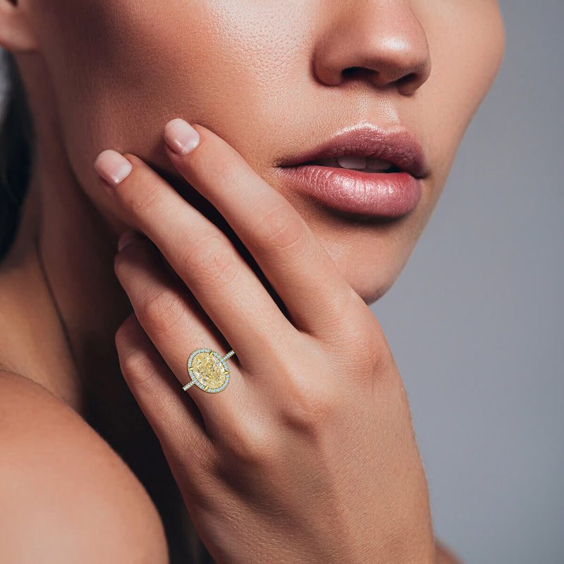 Oval Yellow Diamond Halo Ring