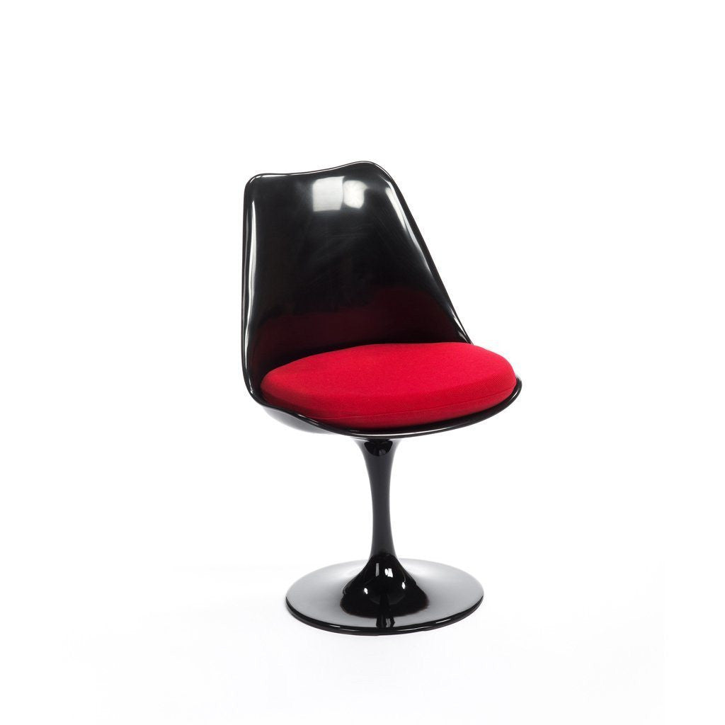 saarinen tulip chair. black saarinen tulip chair with red cushion
