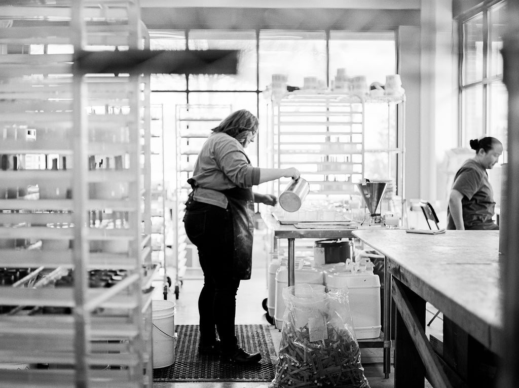 black and white image of a soy candle making studio in grand rapids michigan