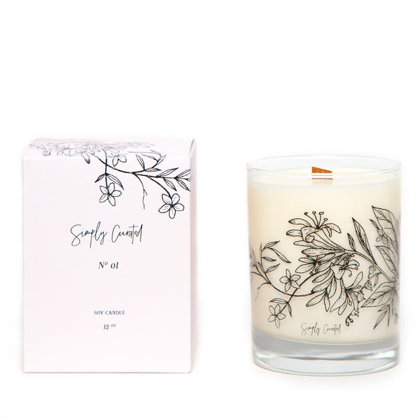honeysuckle jasmine soy candle with floral illustration on the glass with a crackling wooden wick and a blush gift box