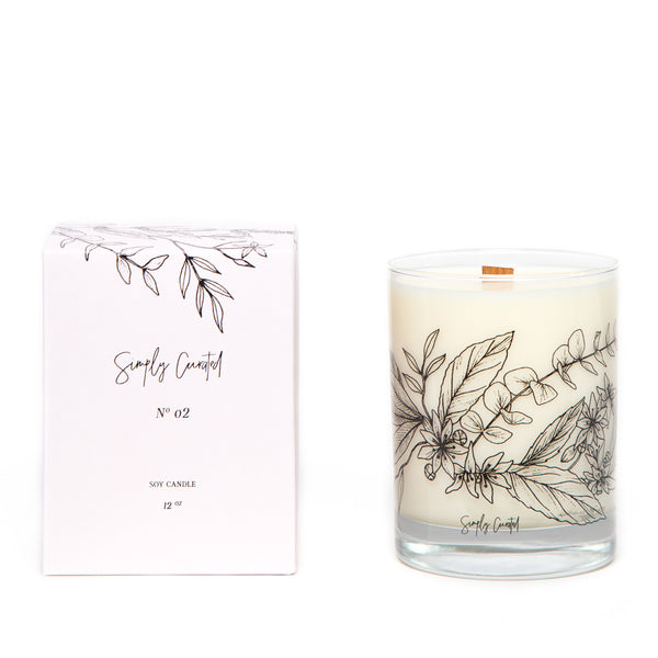 eucalyptus basil star jasmine soy candle with botanical illustration on the glass with a crackling wooden wick and a blush gift box
