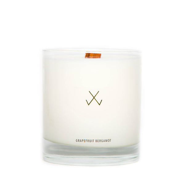 minimalist grapefruit and bergamot soy candle with crackling wooden wick natural white wax and clear glass