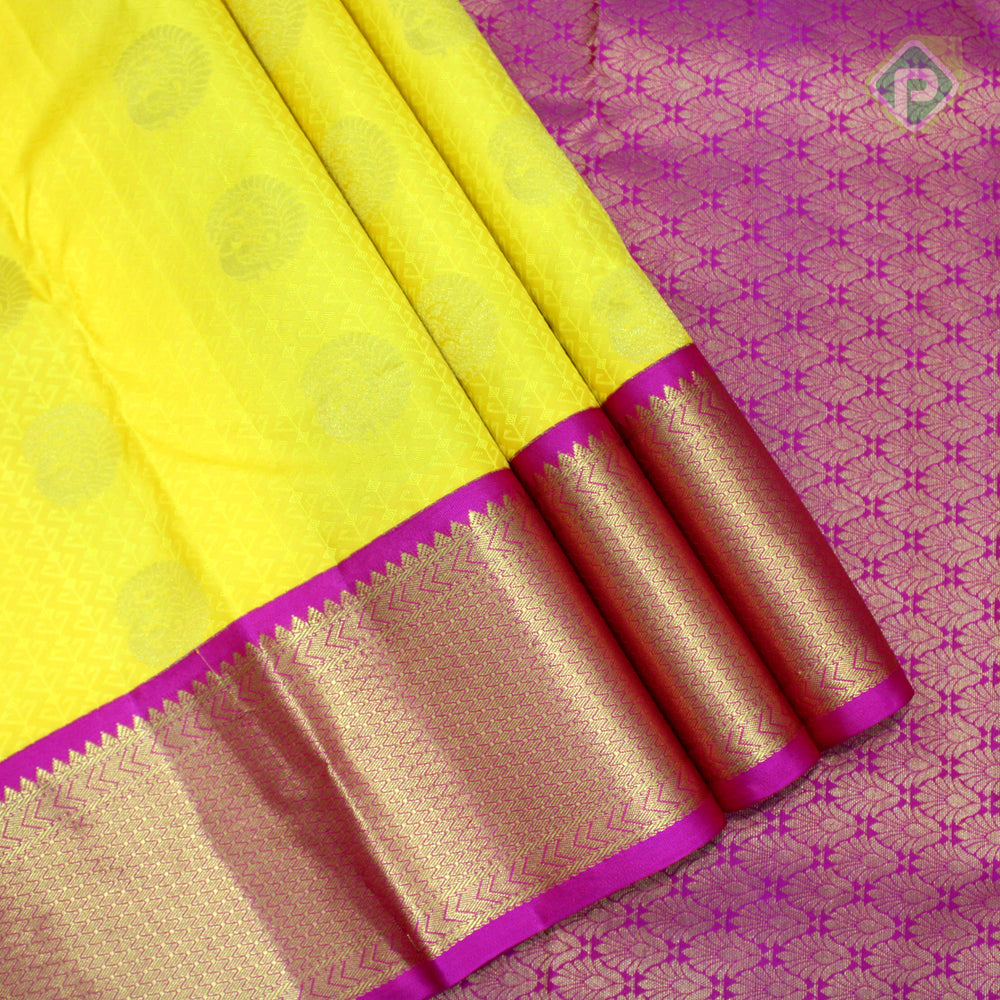 Bright Yellow With Magenta Pink Colour Embossed Silk Saree