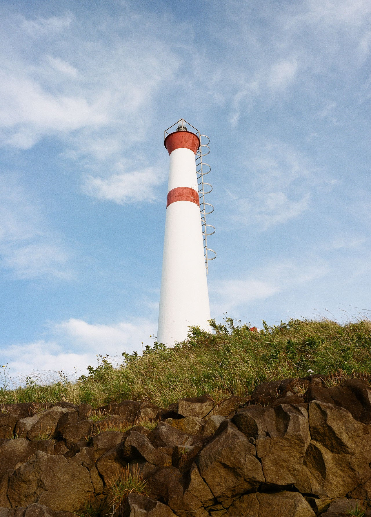 red and white striped lighthouse