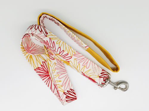Patchwork dog leash in shades of yellow and pink patterned canvas.