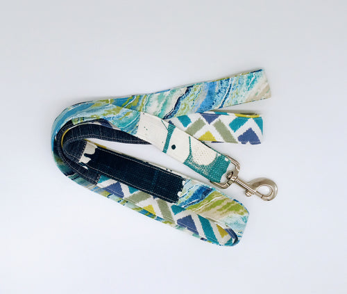 Patchwork dog leash in shades of blue and green patterned canvas and denim.