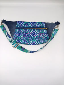 Front view of blue, purple, teal, and denim fanny pack.