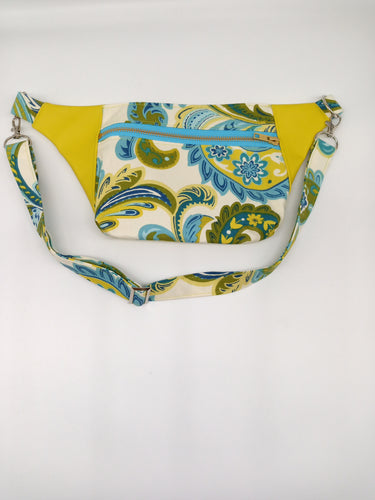 Front view of blue, green, and yellow fanny pack.