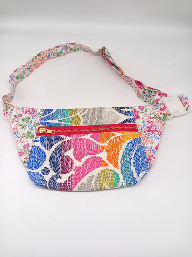 Front view of rainbow colored fanny pack