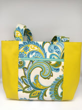 Load image into Gallery viewer, Front view of canvas and vinyl tote bag in blue and green paisley print canvas and yellow vinyl