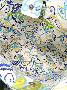 Interior view of blue, green, and yellow floral print tote bag