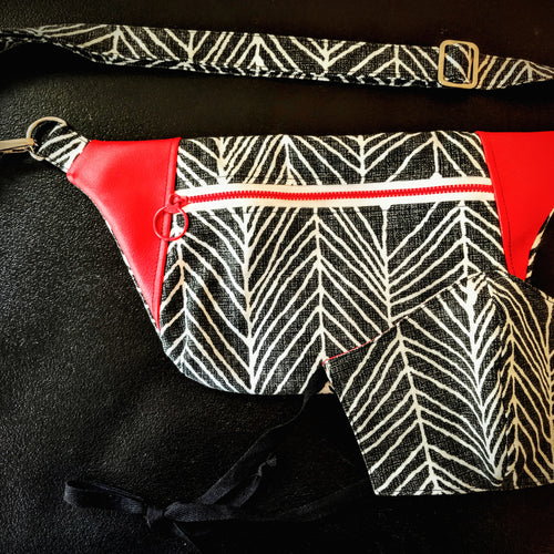 Matching fanny pack and face mask set in black and white print with red accents.