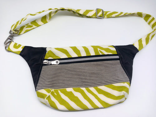 Front view of green zebra print fanny pack with black leather accents