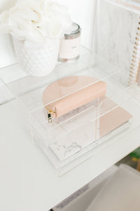 Upper view of the Minima Basics acrylic 2 drawer storage box with a pencil case, notebooks, plants and candle