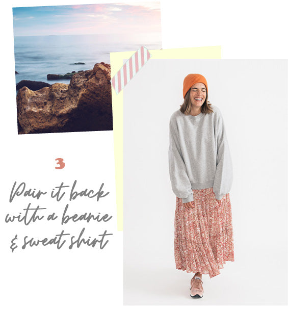 Model wearing the Free People Feeling Groovy Red Combo Maxi Dress styled with a sweater and beanie