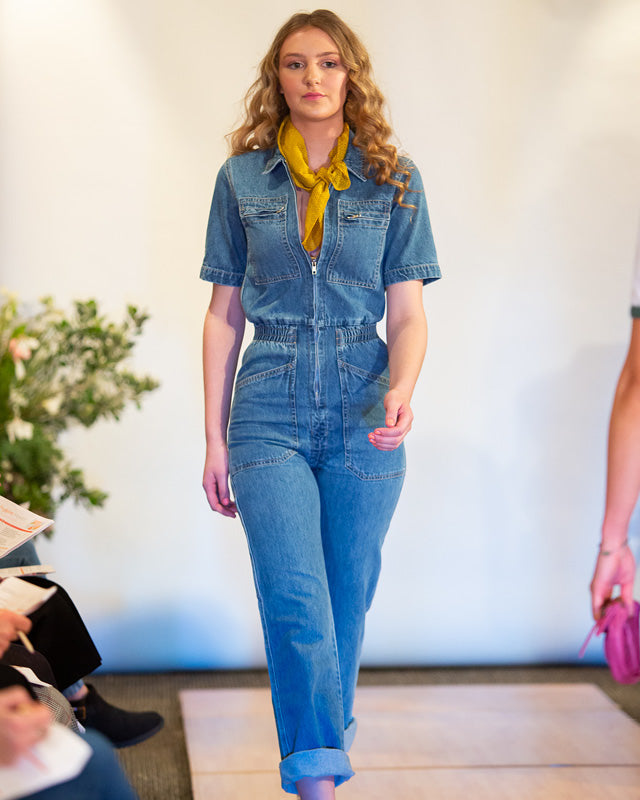 Model wearing the L.F. MARKEY Danny Mid Blue Denim Boilersuit