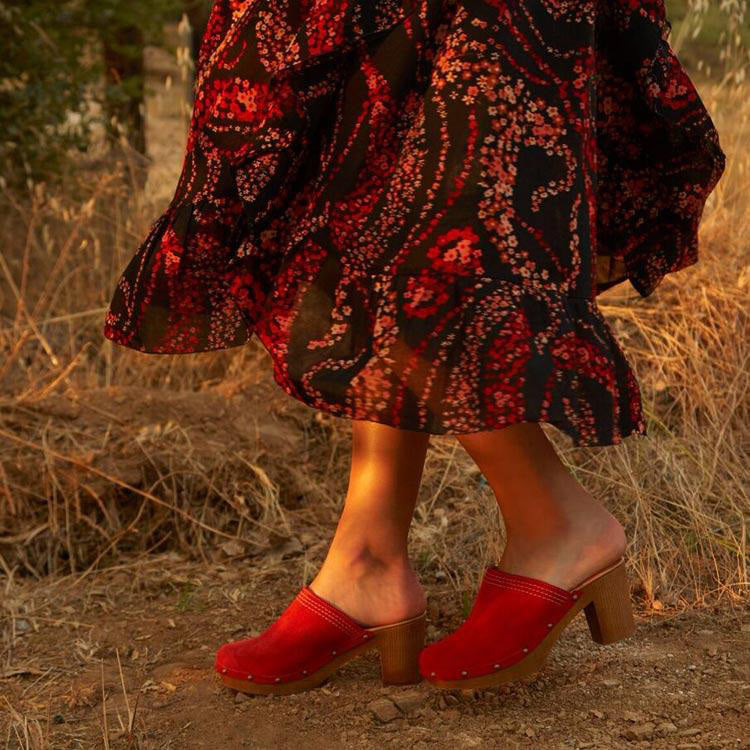 Lifestyle shot of the Penelope Chilvers Flame Red Suede Mid Heel Clogs